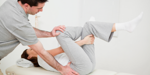 Physiotherapist giving trreatment to woman