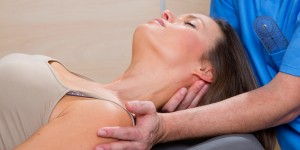 Therapist doing soft tissue release to woman